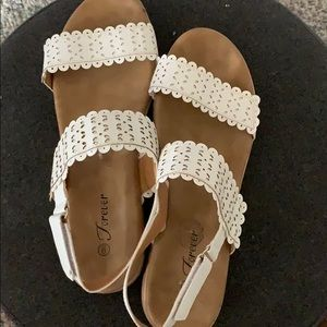 White sandals with double straps.
